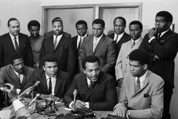 Front Row: Bill Russell, Muhammad Ali, Jim Brown, Kareem abdul-Jabbar Back Row: Mayor Carl Stokes, Walter Beach, Bobby Mitchel, Sid Williams, Curtis McClinton, Willie Davis, Jim Shorter, and John Wooten